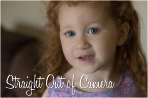 Straight out of camera image of toddler smiling